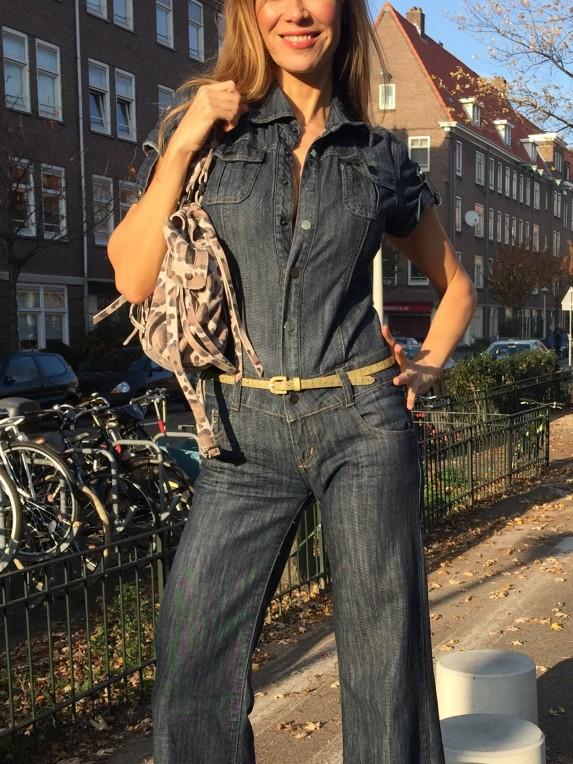 Beertje van Beers wearing a denim jumpsuit, with a FAB belt